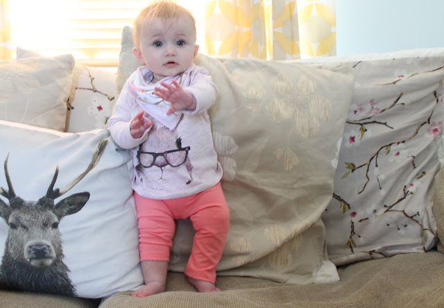 baby wearing pink leggings and Next pink bunny wearing glasses top and Olaf bib