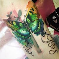 lindo tatuaje de mariposa