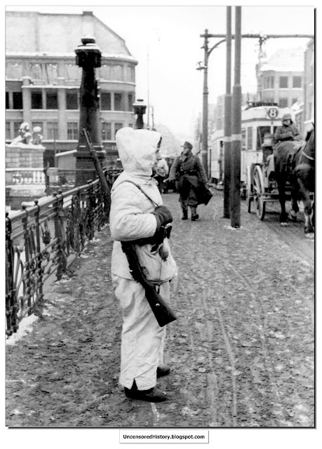 A German soldier stands guard over  bridge centre of Koenigsburg
