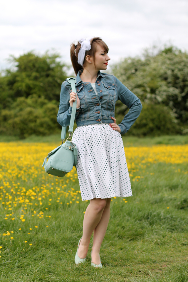 Casual 50s look with denim jacket, headscarf and polka dot skirt.
