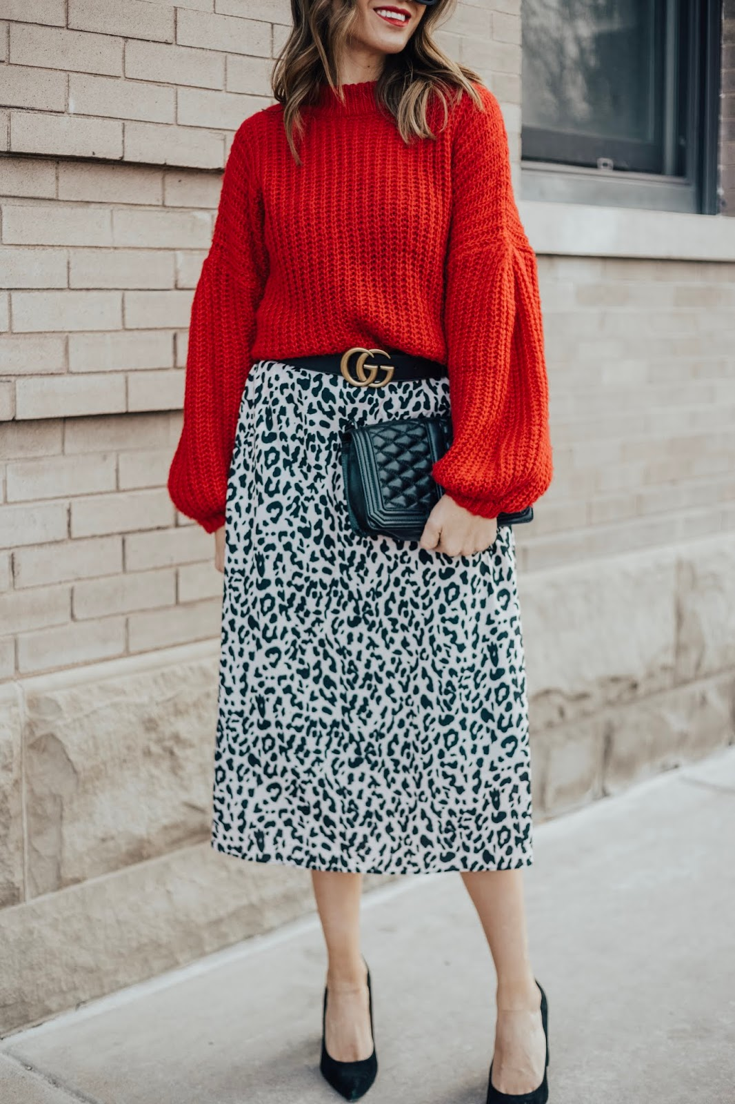 red sweater and leopard skirt