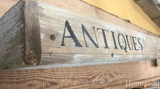 Stenciled Antiques word on a wooden crate