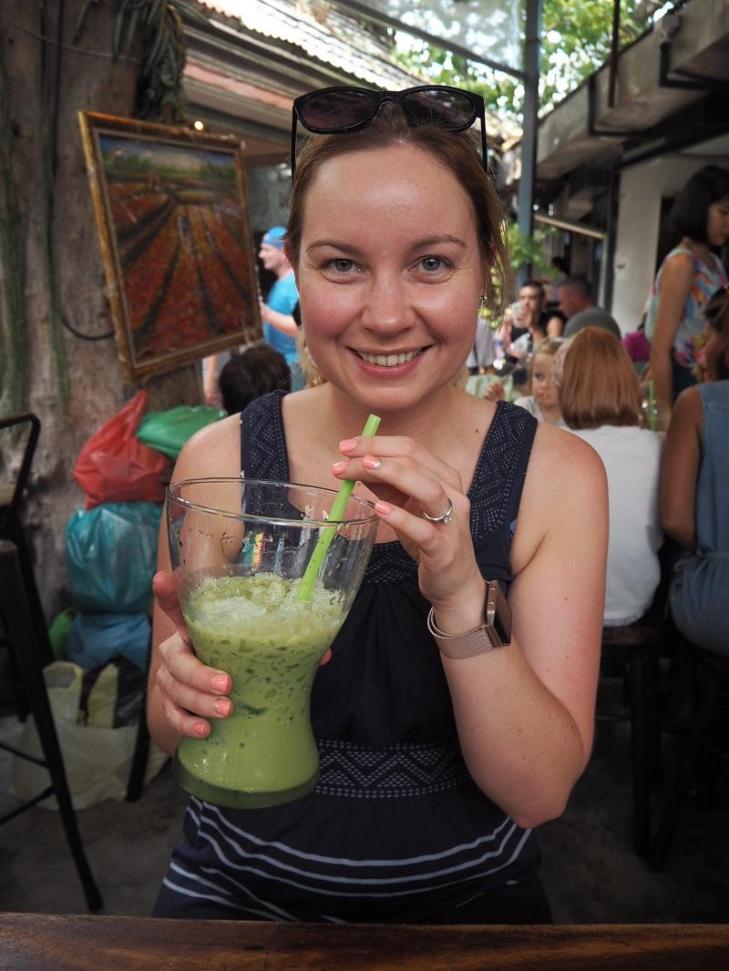 Sipping iced green tea at a market in Bangkok, Thailand