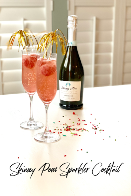 Skinny Pom Sparkler Cocktail is a drink served in a champagne glass with homemade sorbet and champagne