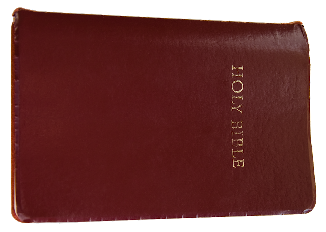 A burgundy leather bible with gold text.