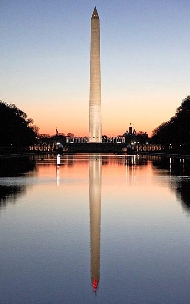 the Washington Monument and Lincoln in Memorial Reflecting Pool at Dusk