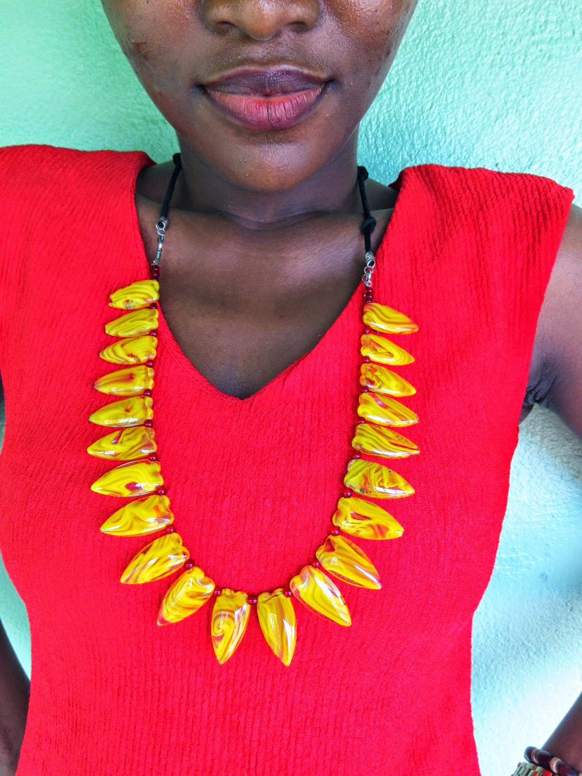 Yellow necklace, red top, office wear, fashion tip