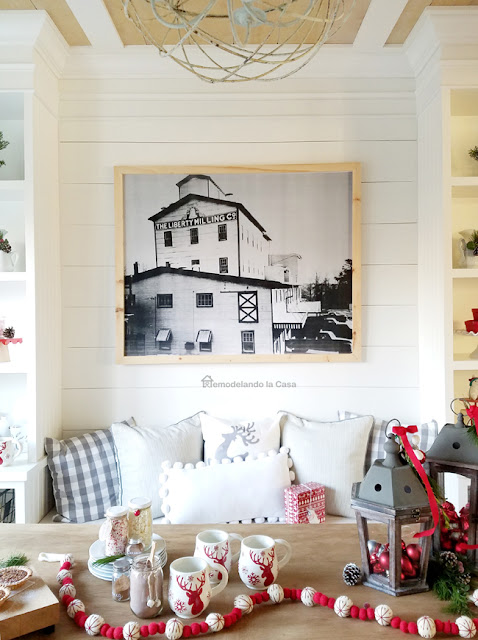 Christmas decor with black and white picture of a mill company on the wall