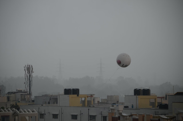 ad balloon in monsoon rains