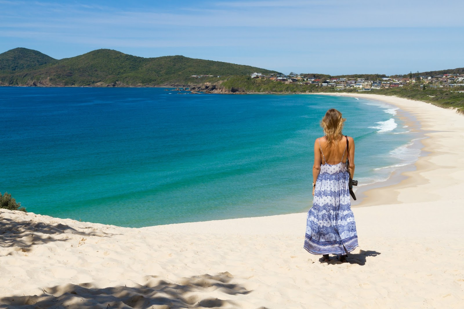 travel and fashion blogger, Alison Hutchinson, at one mile beach in Forster, NSW, Australia