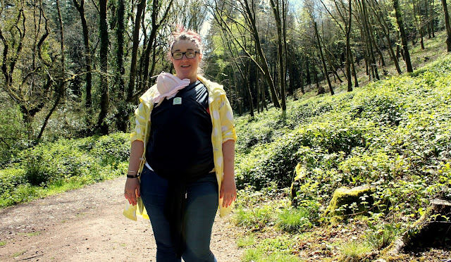 blog review of the KangaWrap baby wearing sling dark blue sling with mother wearing daughter in forest