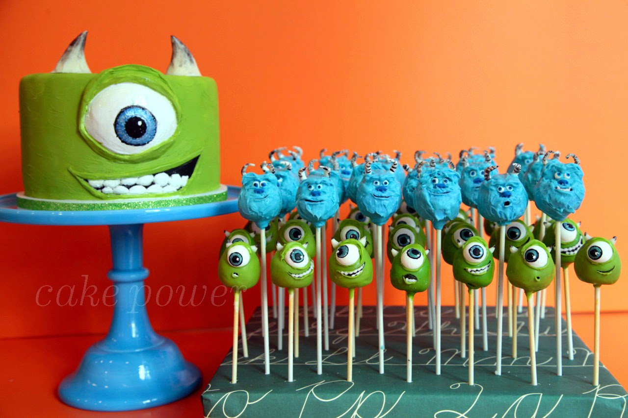 The Finished Mike Cake With Mini And Sulley Pops S Giant Eyeball Lid Are Sculpted From White Modeling Chocolate We Added An