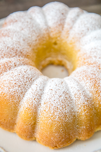 The BEST Homemade Pound Cake - I've been making this cake for over 20 years and it never fails me! Seriously DELICIOUS!!! The key to success is to have all your ingredients at room temperature. Butter, shortening, sugar, eggs, flour, baking powder, milk, vanilla and lemon extract. Can freeze leftover for a sweet treat later! Make this ASAP! #poundcake #dessert #cakerecipe
