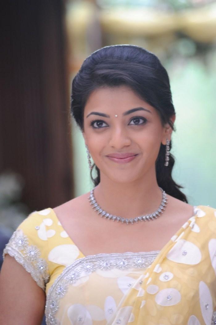 Bollywood Girl Kajal Agarwal Hot Smiling Face Closeup Photos In Yellow Saree