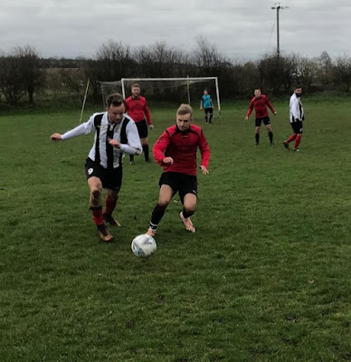 Scunthorpe Football League action from the game between Barnetby United (black and white shirts) and Limestone Rangers on January 12, 2019 - see Nigel Fisher's Brigg Blog