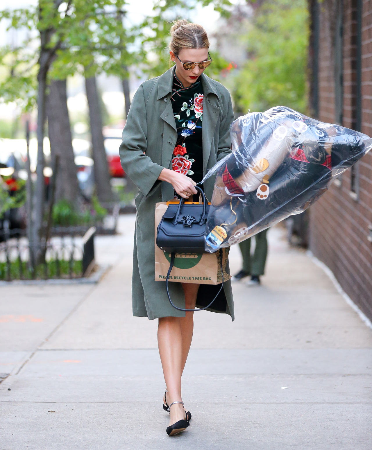 Karlie Kloss Wears Green Velvet Dress in NYC