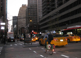 Bicycles in a bike lane alongside taxis, New York, New York