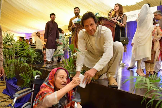 Awkward photos which show Pakistani cricketer-politician Imran Khan  crouching on the stage to felicitate disabled persons have gone viral.  In the event held at Shaukat Khanum Memorial Cancer Hospital in Islamabad, which was built by Imran Khan in memory of his mother, organisers forgot to build ramps.