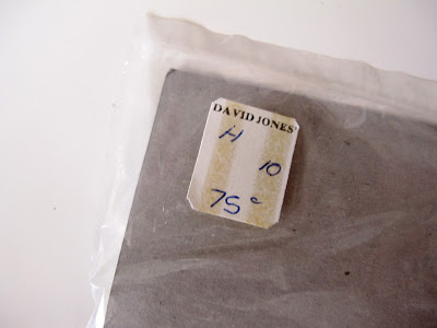 Back of a plastic bag with a David Jones price sticker on it showing a price of 75 cents.