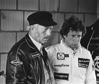 Mario Andretti with Lotus boss Colin Chapman (left) during the 1978 Formula One championship-winning season