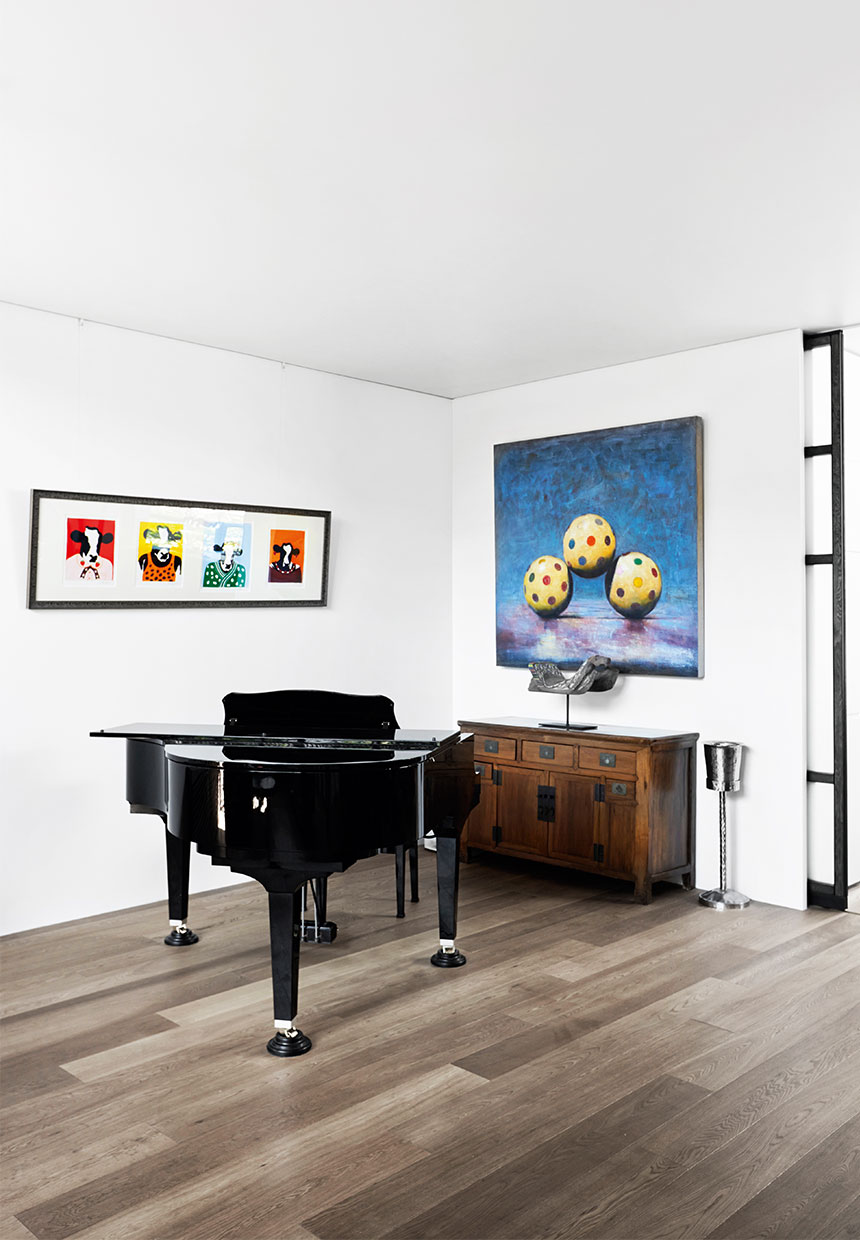 piano, art and vintage cabinet inside of a japanese architects house