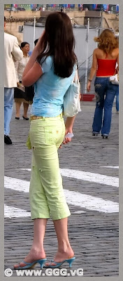 Girl in light-green breeches on the street