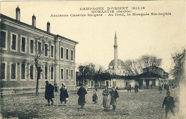 View toward the Municipal building and Isac mosque with the shops along the river Dragor in 1918. The municipal building is shown as a former Bulgarian barrack and Isac mosque is named Hagia Sophia.