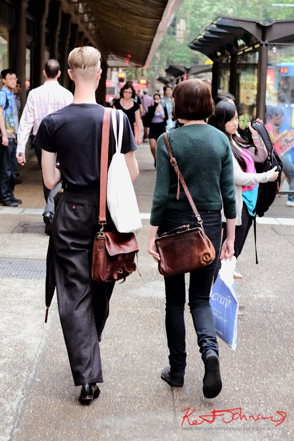 Vintage style - grey flannel trousers, leather satchel - men's hair, short back and sides long on top..