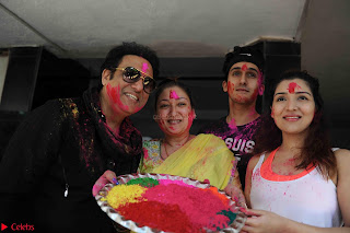 Govinda celeting Holi with His family wife daughter 005.JPG