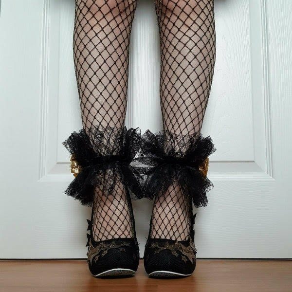 black shoes with gold stars worn with fishnets and black lace handmade ankle cuffs