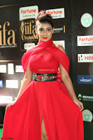 Apoorva in a Stunning Tight Leg Split Sleeveless Red Gown at IIFA Utsavam Awards 013.JPG