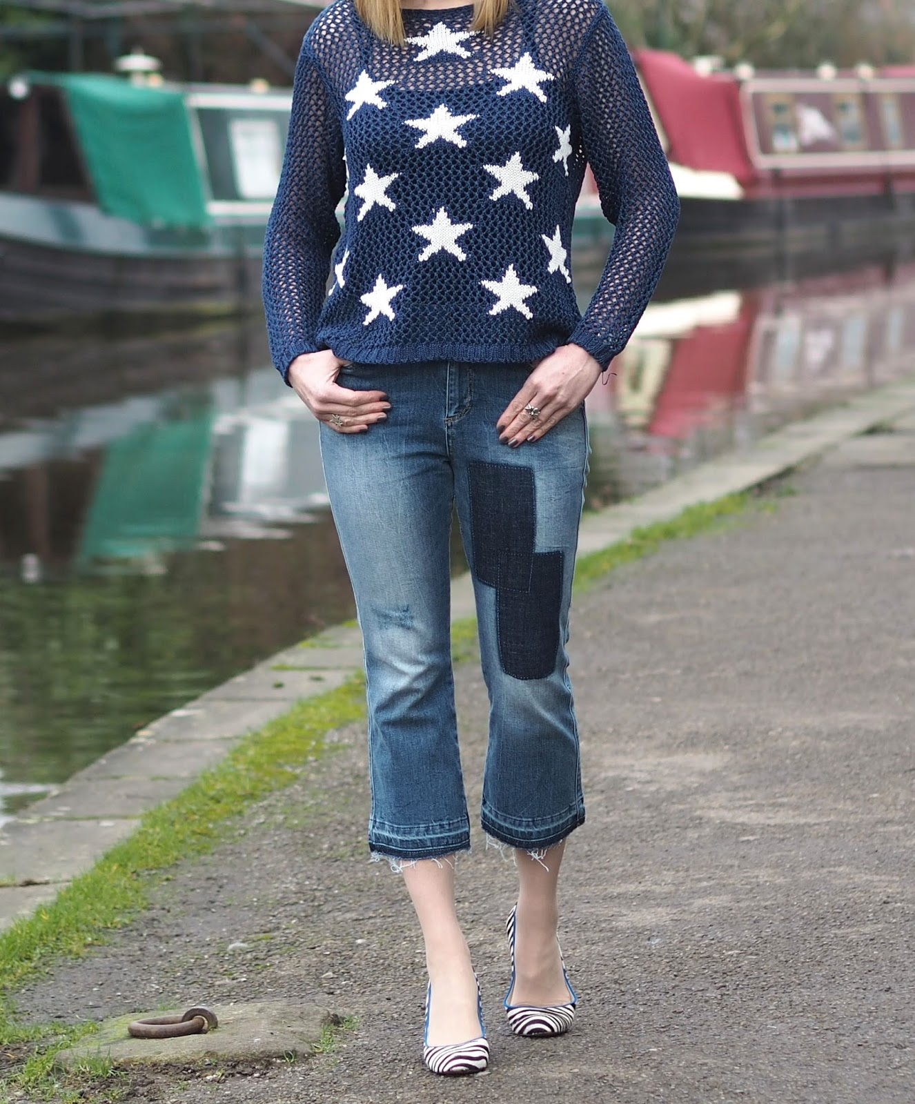 Pointelle star sweater, frayed patch jeans, zebra high-heeled shoes with blue trim, over 40