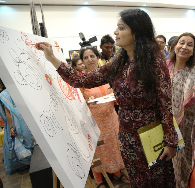 Amruta Fadnavis trying her hands at painting at Art Trisomy 21, a 2-day art exhibition by specially abled