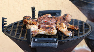 Chicken and burgers sizzling on the grill