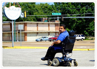 Wheelchair user in the road