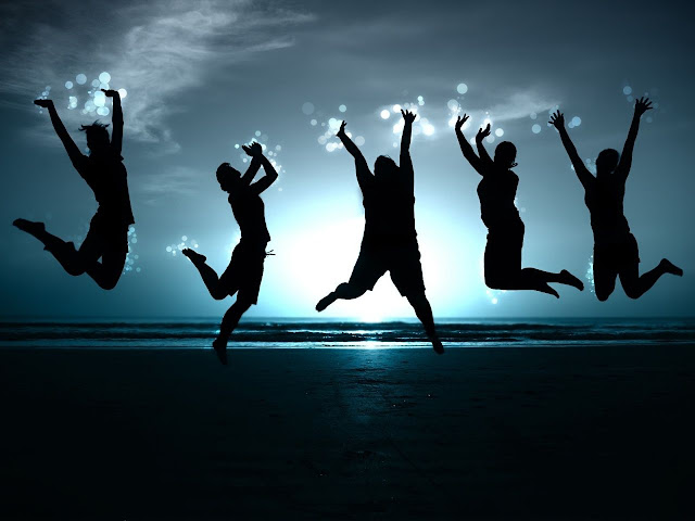 Friends are jumping together in Happy mood on beach at sun set