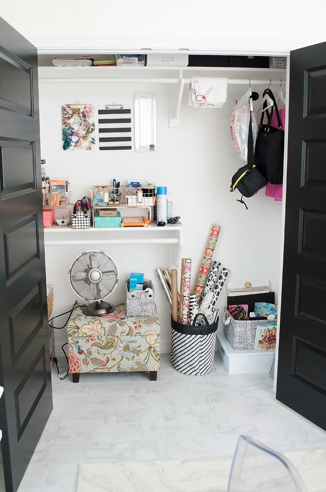 Home office closet organized with baskets and various storage boxes.