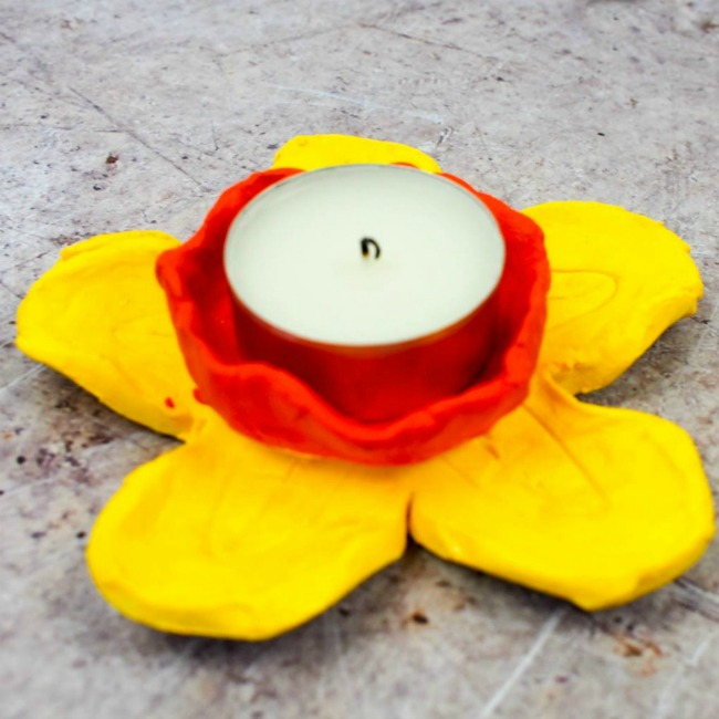 Clay craft ideas for kids. Daffodil clay candle made from polymer clay.