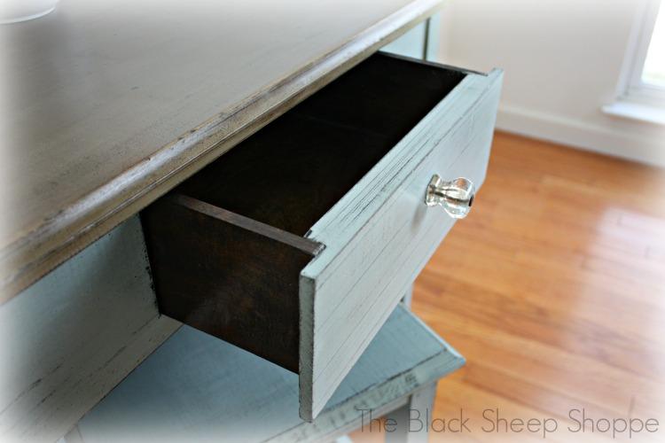 Storage in center drawer.