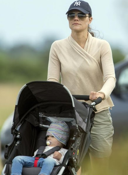 Crown Princess Victoria and Prince Daniel have been seen  walking near Solliden with Princess Estelle and Princess Madeleine and Christoper O'Neill