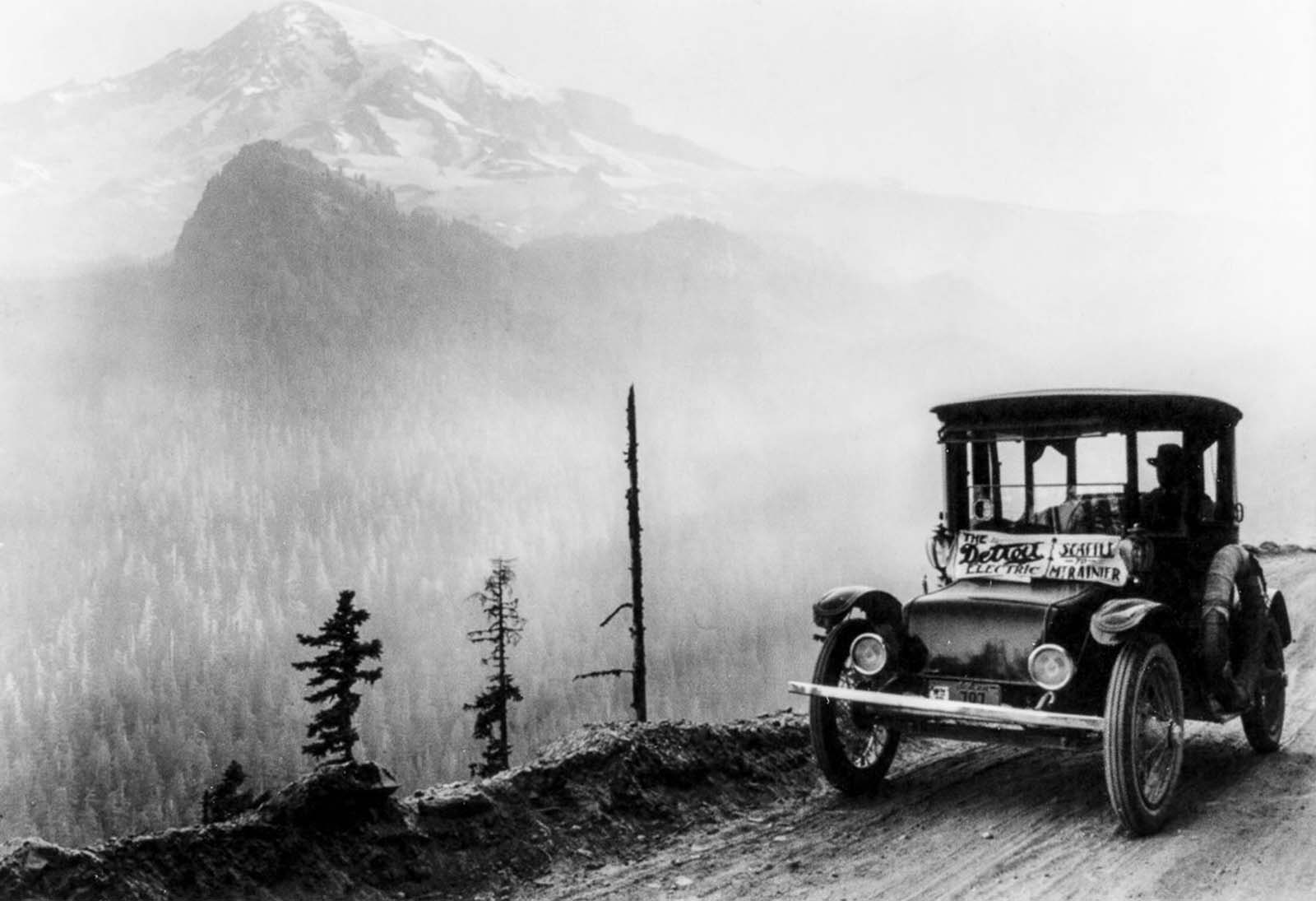 A Detroit Electric car drives on a mountain road between Seattle and Mount Rainier, Washington. 1920.
