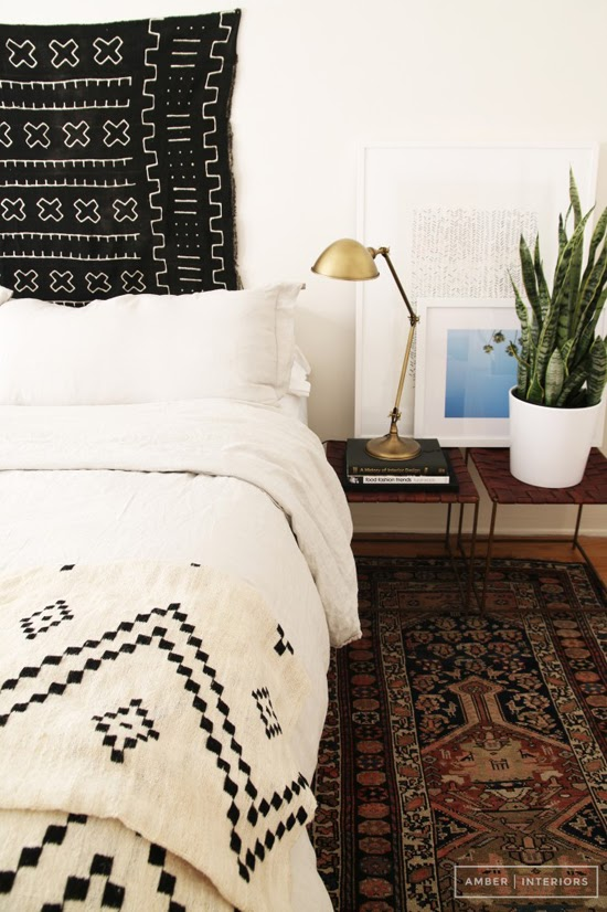Safari Fusion blog | Obsession: Mud cloth | Beautiful black Bogolan cloth as a wall hanging behind a bed via Amber Interiors