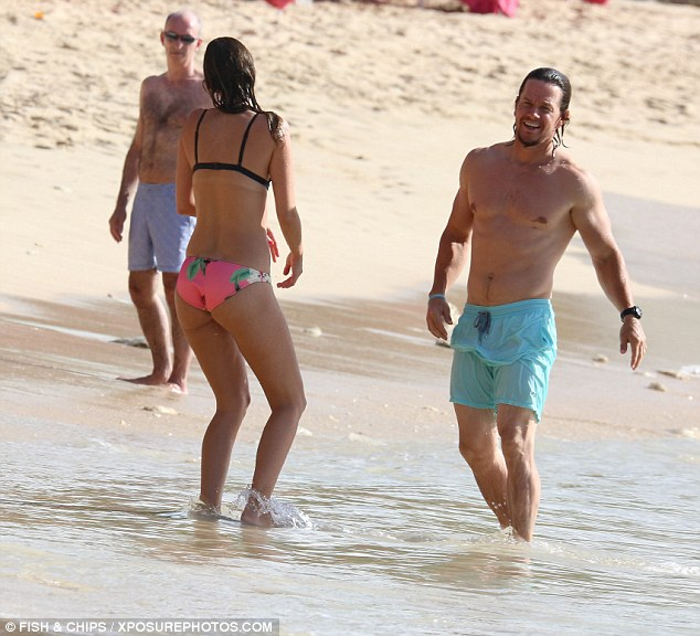 mark wahlberg and his wife rhea durham cooling off on the beach in barbados photos