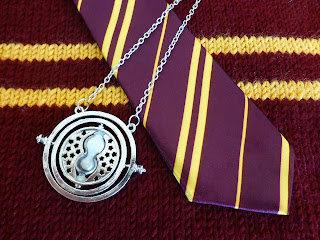 Griffindor tie, sweater, and time turner