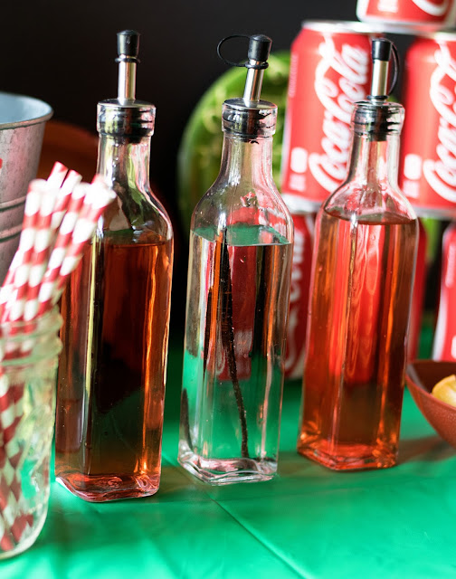 The syrup bottles for the Coca-Cola Bar