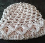 http://www.ravelry.com/patterns/library/little-petals-baby-crocodile-stitch-hat---3-sizes