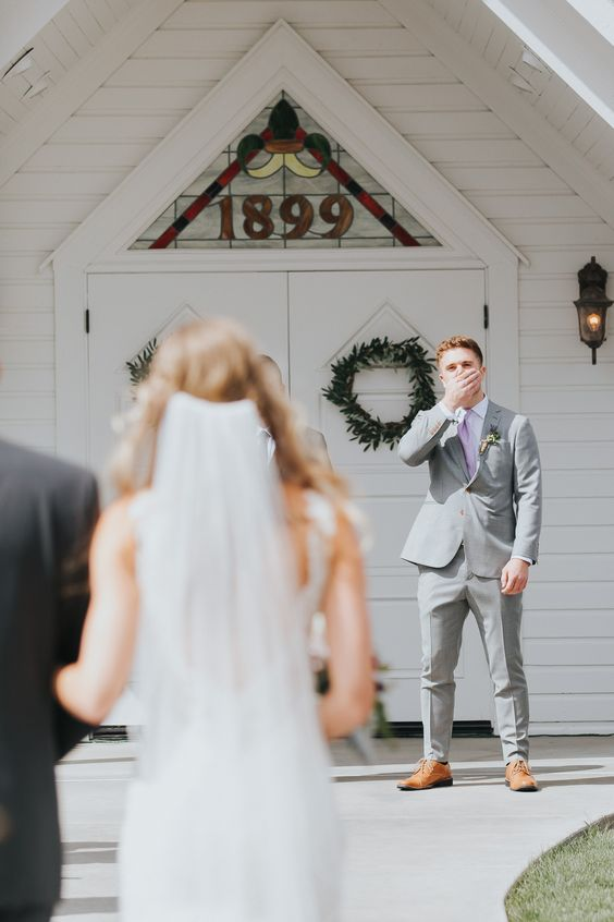 Groom's reaction - crying groom - crying husband - emotional wedding photos - wedding photography - excited groom - walking down the aisle - photography - bride and father