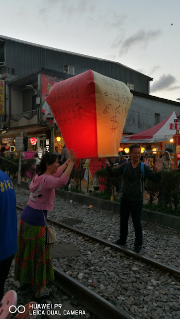 Photo op before tossing the lantern into the air!