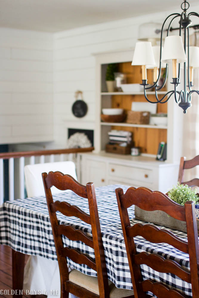 Farmhouse style painted hutch by Yield House in dining room with plank walls, shiplap
