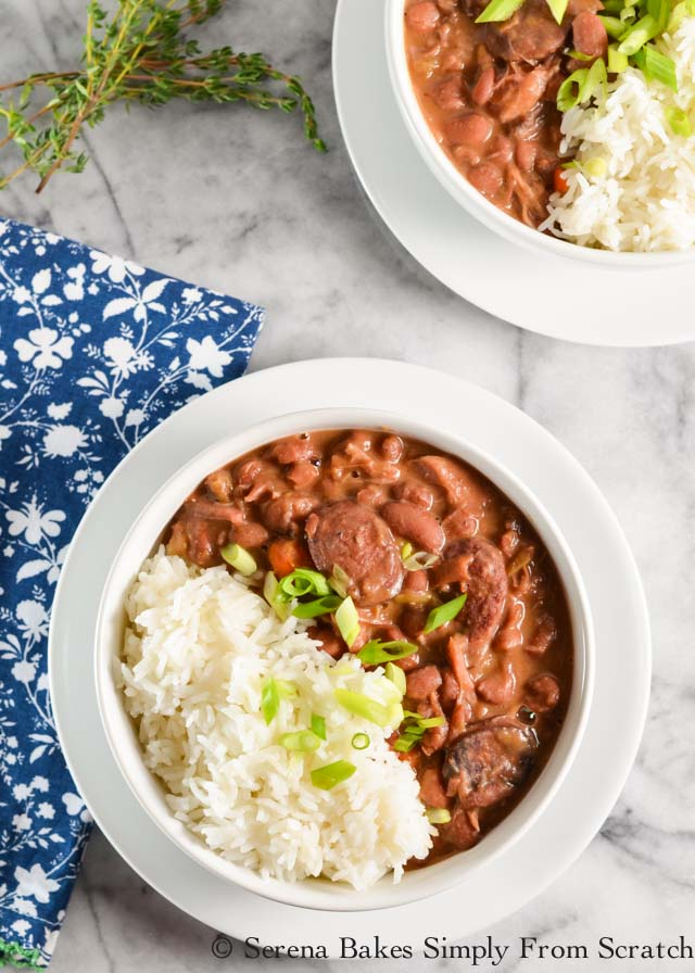 Meaty Red Beans and Rice with ham hock and andouille sausage is the perfect stick to your bones feel good dinner like you would find in the South from Serena Bakes Simply From Scratch.